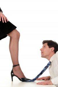businesswoman dominating businessman