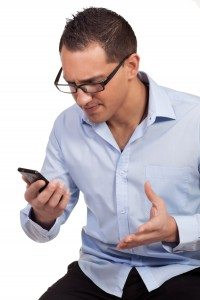 Man annoyed by his mobile phone