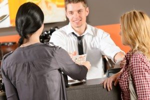 Female customers paying by cash CZK bar