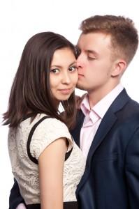 Man kissing his girlfriend on the cheek