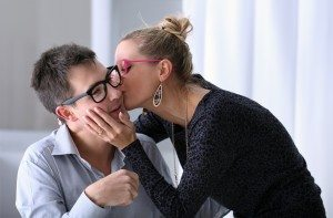 happy young couple kissing in the office