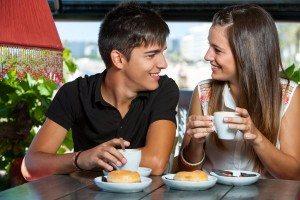 teen couple enjoying coffee together.
