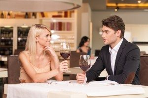 Beautiful couple drinking wine at restaurant.