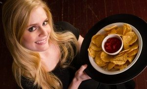 Young Attractive Female Server Brings Appetizer Chips Salsa Food