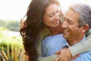 Loving Hispanic Couple In Countryside