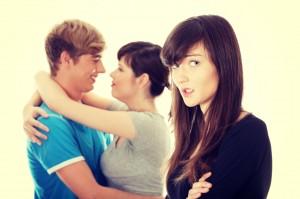 Sad brunette girl jealousy about her friend