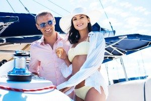 Attractive and rich couple have a party on a luxorious boat