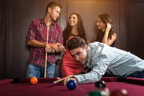 three ladies are playing billiards and having unforgettable threesome  24107