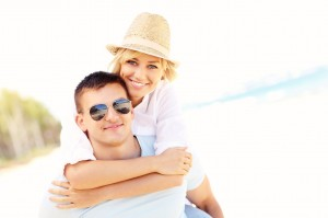 Romantic couple hugging at the beach