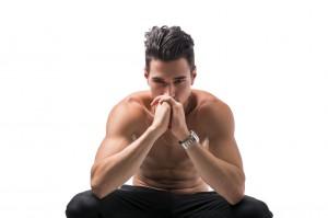 Shirtless man deep in contemplation