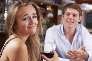 Couple On Unsuccessful Blind Date In Restaurant