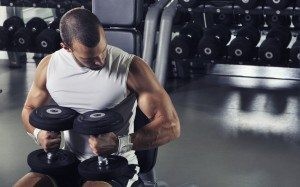 Handsome Muscular Male Model Posing With Dumbbells