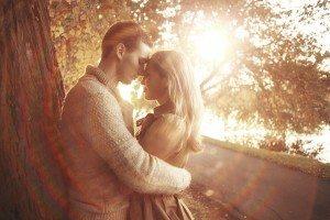loving couple in autumn park sunbeams sunset