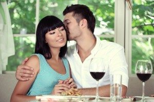 Beautiful young couple at restaurant