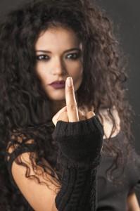 Rocker girl making middle finger gesture