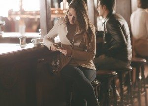 Attractive woman sitting at the bar counter