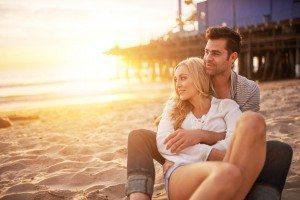 romantic couple having fun at santa monica on beach