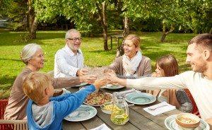 happy family having dinner in summer garden