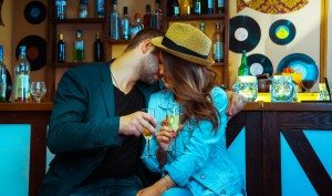 Woman seducing a man in a bar and drinking champagne