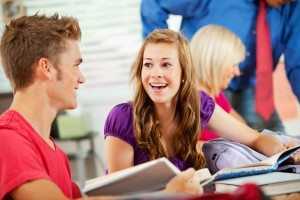High School: Girl Student Laughs With Friend