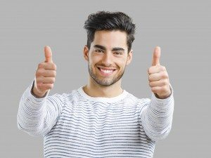 Handsome man with thumbs up